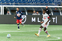 FOXBOROUGH, MA - OCTOBER 7: Richie Laryea #22 of Toronto FC passes the ball during a game between Toronto FC and New England Revolution at Gillette Stadium on October 7, 2020 in Foxborough, Massachusetts.