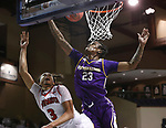 SIOUX FALLS, SD - MARCH 6: Xavier Fuller #3 of the South Dakota Coyotes tries to get a layup past Ramean Hinton #23 of the Western Illinois Leathernecks during the Summit League Basketball Tournament at the Sanford Pentagon in Sioux Falls, SD. (Photo by Richard Carlson/Inertia)