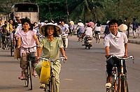 Cyclists crossing a bridge, Hue, Vietnam.