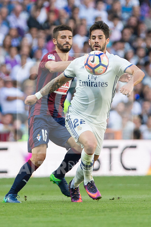 Eibar's Ruben Pena and Real Madrid's Isco Alarcon during the match of La Liga between Real Madrid and SD Eibar at Santiago Bernabeu Stadium in Madrid. October 02, 2016. (ALTERPHOTOS/Rodrigo Jimenez)