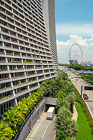 The south side of the Marina Bay Sands resort hotel with the Singapore Flyer ferris wheel in the background.
