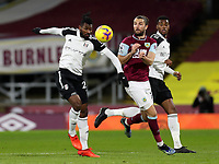 17th February 2021; Turf Moor, Burnley, Lanchashire, England; English Premier League Football, Burnley versus Fulham; Andre-Frank Zambo Anguissa of Fulham controls the ball under pressure from Jay Rodriguez of Burnley