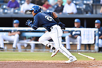 Asheville Tourists Daniel Montano (24) runs to first base during a game against the Lakewood BlueClaws at McCormick Field on August 3, 2019 in Asheville, North Carolina. The BlueClaws defeated the Tourists 10-6. (Tony Farlow/Four Seam Images)
