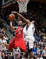 11 November 2009:  Xavier Keeling of Detroit shoots the ball away from Markhuri Sanders-Frison of California during the game at Haas Pavilion in Berkeley, California.   California defeated Detroit, 95-61.