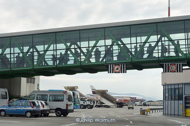 Passengers wait to board a plane at Bergamo airport