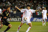 Costa Rica's Jose Salvatierra plays the ball in front of Mexico's Hector Moreno.  Mexico defeated Costa Rica 4-1 at the 2011 CONCACAF Gold Cup at Soldier Field in Chicago, IL on June 12, 2011.