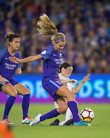 Orlando, FL - Saturday March 24, 2018:  Orlando Pride midfielder Dani Weatherholt (17) is challenged by a sliding Utah Royals midfielder Diana Matheson (10) during a regular season National Women's Soccer League (NWSL) match between the Orlando Pride and the Utah Royals FC at Orlando City Stadium. The game ended in a 1-1 draw.