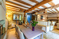 BNPS.co.uk (01202 558833)<br /> Pic: Strutt&Parker/BNPS<br /> <br /> Pitcured: Dining/Living room. <br /> <br /> An 18th century cottage in 'the prettiest village in England' is on the market for £675,000.<br /> <br /> Number 2 School Lane is Grade II listed, built with beautiful Cotswold stone and filled with character features like exposed timber beams and original fireplaces.<br /> <br /> The attractive three-bedroom property is in the highly sought after Wiltshire village of Castle Combe.<br /> <br /> The quintessentially English village has been used regularly as a film location and the houses are mostly made with honey-coloured Cotswold stone.