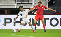 WASHINGTON, D.C. - OCTOBER 11: Rolando Abreu #7 of Cuba and Jordan Morris #11 of the United States battle for the ball during their Nations League game versus Cuba at Audi Field, on October 11, 2019 in Washington D.C.