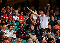"""10th July 2021; Twickenham, London, England; International Rugby Union England versus Canada; An enthusiastic supporter leading the chant """" sweet chariot'"""