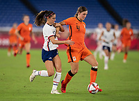 YOKOHAMA, JAPAN - JULY 30: Alex Morgan #13 of the USWNT fights for the ball with Aniek Nouwen #14 of the Netherlands during a game between Netherlands and USWNT at International Stadium Yokohama on July 30, 2021 in Yokohama, Japan.