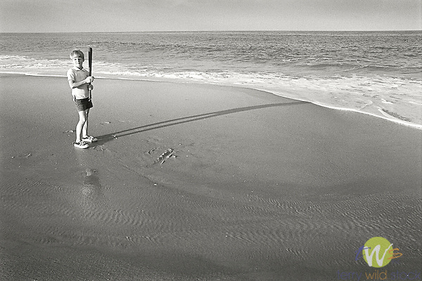 Rehoboth Beach, Delaware. 1973. Hank DuPont on beach with baseball bat.