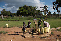 N. Uganda, Gulu District. Peter C. Alderman Foundation project. Children pumping water from the well at the rural clinic.
