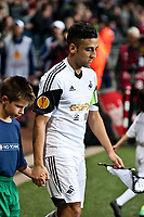 Thursday 24 October 2013  <br /> Pictured:  Neil Taylor leads the team on to the pitch as captain <br /> Re:UEFA Europa League, Swansea City FC vs Kuban Krasnodar,  at the Liberty Staduim Swansea