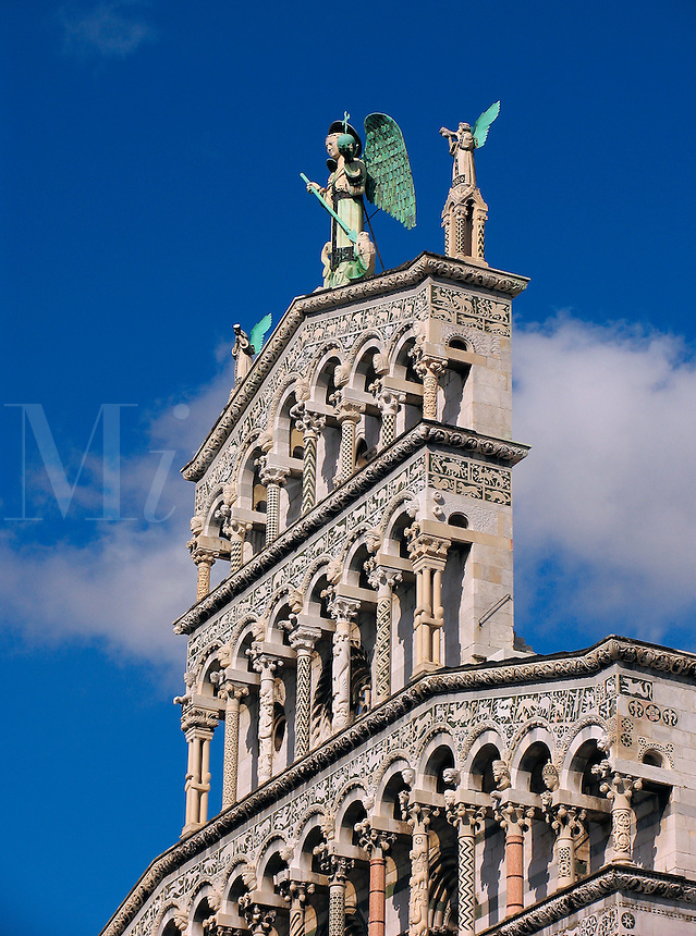 Lucca, Italy, San Michele in Foro, marble columns and Cosmati work adorns Pisan-Romanexque facade of church built on site of the old Roman Forum between the 11th and 14th centuries, winged figure of St. Michael on pedimen