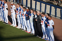 The Kannapolis Cannon Ballers stand for the National Anthem prior to the game against the Fayetteville Woodpeckers at Atrium Health Ballpark on June 23, 2021 in Kannapolis, North Carolina. (Brian Westerholt/Four Seam Images)