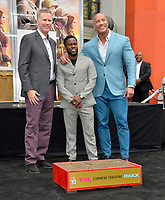 LOS ANGELES, USA. December 10, 2019: Will Ferrell, Kevin Hart & Dwayne Johnson at the handprint & footprint ceremony for Kevin Hart at the TCL Chinese Theatre.<br /> Picture: Paul Smith/Featureflash