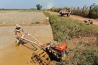 LAOS, rice research NAFRI, ploughing of paddy field where rice seeds will be produced / LAOS Vientiane NAFRI Forschungsinstitut fuer Land- u. Forstwirtschaft, Reis Versuchsfelder und Anbau von Hybrid Reis zur Gewinnung von Saatgut, Pfluegen eines Feldes mit Motorpflug