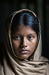 28 MAY, 2014, Gazipur District, Dhaka, Bangladesh.  Child marriage is an ongoing issue in Bangladesh where nearly two thirds of women are married before age 18.  Marriage before the age of 13 is common and two percent are married before age 11. <br /> Rokshana (16) was married to 20 year old Asadul Islam on Boxing Day 2013. She lost her mother at age four and has ended up the pawn in a familial property battle in her village that resulted in her marriage to keep land in the families involved. Despite this she says she is happy and her husband has encouraged her to stay in school. Picture by Graham Crouch/ The Australian Magazine<br /> <br /> Khadiza Akther is 14 years old and has a 9 month old baby Fahim with her 18 year old husband Omar Farukh.