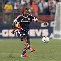 New England Revolution defender Andrew Farrell (2) passes the ball.  In a Major League Soccer (MLS) match, Real Salt Lake (white)defeated the New England Revolution (blue), 2-1, at Gillette Stadium on May 8, 2013.