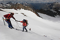 "Workers rappel off the side of a slope to attach a blanket to Brunnenkogel Ferner (Austrian word for glacier).  It is being wrapped with a fleece-like cover to keep it from melting. Covered ice melts slower. <br /> The ski area at 3,400 meters is covered to help save the ski industry since the glacier is retreating.  The cost of materials is one Euro per square meter.<br /> <br /> The Alpine glaciers -- in Austria, Switzerland, France and Italy -- are losing one percent of their mass every year and, even supposing no acceleration in that rate, will have all but disappeared by the end of the century. More hot, dry summers like that of 2003 in Europe, when the loss speeded to five percent, could cut the life expectancy to no more than 50 years, according to Wilfried Haeberli of the University of Zurich...""We estimate that by the end of the 21st century, with a medium-type climate scenario, about five percent of what existed in the 1970s will have survived, he added."