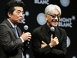 """December 21, 2016, Tokyo, Japan - Japanese composer Ryuichi Sakamoto, a member of the Yellow Magic Orchestra (YMO) is celebrated from his friend and a Japanese author Ryu Murakami (L) after he received Montblanc de la Culture Arts Patronage Award in Tokyo on Wednesday, December 21, 2016. Sakamoto played his screen music """"Merry Christmas Mr. Lawrence"""" with young musicians.  (Photo by Yoshio Tsunoda/AFLO) LWX -ytd-"""