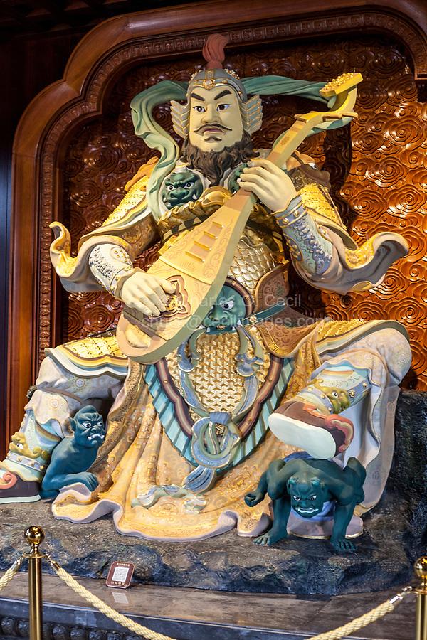 Nanjing, Jiangsu, China.  Niushou Mountain Buddhist Ashram.  Chi Guo Tianwang, one of the four heavenly kings.  King of the East and God of Music, playing his pipa.