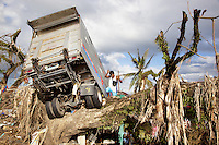 Philippines. Province Leyte. Tacloban. An truck was swept away, lifted off the ground and dumped several metres away and destroyed by typhoon Haiyan's winds and storm surge. Typhoon Haiyan, known as Typhoon Yolanda in the Philippines, was an exceptionally powerful tropical cyclone that devastated the Philippines. Haiyan is also the strongest storm recorded at landfall in terms of wind speed. Typhoon Haiyan's casualties and destructions occured during a powerful storm surge, an offshore rise of water associated with a low pressure weather system. Storm surges are caused primarily by high winds pushing on the ocean's surface. The wind causes the water to pile up higher than the ordinary sea level. 1.12.13 © 2013 Didier Ruef