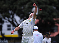 Michael Rae reaches for the ball during day three of the Plunket Shield match between the Wellington Firebirds and Otago Volts at Basin Reserve in Wellington, New Zealand on Saturday, 7 November 2020. Photo: Dave Lintott / lintottphoto.co.nz