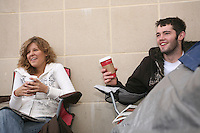 """State College, PA -- 10/25/2007 -- Penn State freshmen Maddy Hoover (left) and Sean Burdette, both from Spring Grove, sit outside of the gates of Beaver Stadium next to their rain soaked tent on Thursday morning.  As of Thursday morning, Burdette had been living in his tent for over 56 hours, and was the first in line.  Penn State students camp outside of Beaver Stadium in hopes to be near the front of the student section for the game against Ohio State this Saturday.  The gathering of tents outside of the student entrance to the stadium has been dubbed """"Paternoville"""" and received a visit from its namesake, Joe Paterno, and his wife, Sue, this morning.  The Paterno's delivered pizza to the students and thanked them for their support of the football team...Photo:  Joe Rokita / JoeRokita.com"""