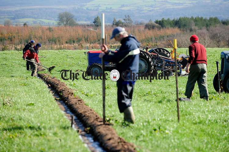 Preparing the scribe marks during the ploughing match at O'Callaghans Mills.pic Arthur Ellis.