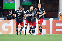 FOXOBOROUGH, MA - AUGUST 21: New England Revolution players celebrate the Adam Buska #9 of New England Revolution goal during a game between FC Cincinnati and New England Revolution at Gillette Stadium on August 21, 2021 in Foxoborough, Massachusetts.