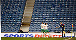Hibs celebrate their second goal with no Rangers fans and Sports Direct branding everywhere