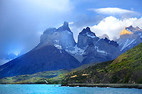 CHILE - NP Torres del Paine<br /> Dark storm clouds approach Lago Pehoe and the Torres del Paine Massif