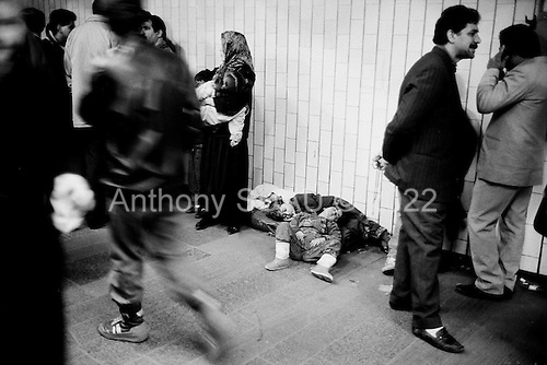 """Moscow, Russia<br /> October, 1992<br /> <br /> Central train station.<br /> <br /> In December 1991, food shortages in central Russia had prompted food rationing in the Moscow area for the first time since World War II. Amid steady collapse, Soviet President Gorbachev and his government continued to oppose rapid market reforms like Yavlinsky's """"500 Days"""" program. To break Gorbachev's opposition, Yeltsin decided to disband the USSR in accordance with the Treaty of the Union of 1922 and thereby remove Gorbachev and the Soviet government from power. The step was also enthusiastically supported by the governments of Ukraine and Belarus, which were parties of the Treaty of 1922 along with Russia.<br /> <br /> On December 21, 1991, representatives of all member republics except Georgia signed the Alma-Ata Protocol, in which they confirmed the dissolution of the Union. That same day, all former-Soviet republics agreed to join the CIS, with the exception of the three Baltic States."""