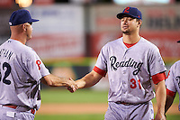 Reading Fightin Phils right fielder Dylan Cozens (31) shakes hands with manager Dusty Wathan (62) after a game against the Portland Sea Dogs on May 31, 2016 at Hadlock Field in Portland, Maine.  Reading defeated Portland 6-4.  (Mike Janes/Four Seam Images)