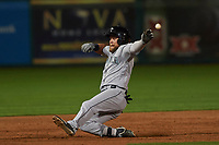 Peoria Javelinas right fielder Eric Filia (4), of the Seattle Mariners organization, slides into third base for a ninth inning triple during an Arizona Fall League game against the Scottsdale Scorpions on October 20, 2017 at Scottsdale Stadium in Scottsdale, Arizona. the Javelinas defeated the Scorpions 2-0. (Zachary Lucy/Four Seam Images)