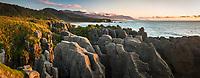 Sunset on rock formations at Dolomite Point in Punakaiki, Paparoa National Park, Buller Region, West Coast, New Zealand, NZ