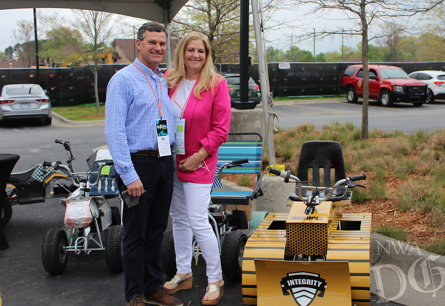 Michael and Laura Parker stand by the Nabholz 24-volt Zing Cup race entrant at the UnGala on April 24.<br /> (NWA Democrat-Gazette/Carin Schoppmeyer)