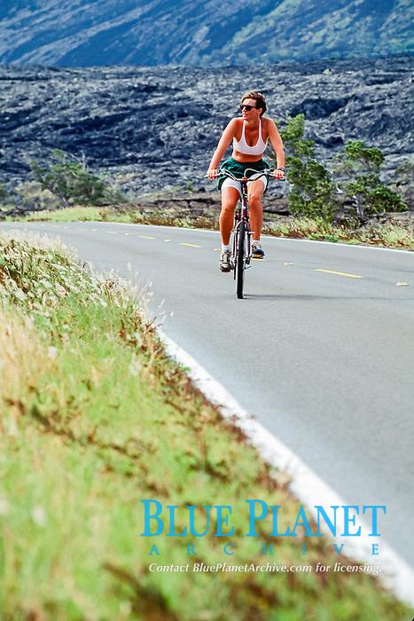 woman biking the Chain of Craters Road, Hawaii, USA Volcanoes National Park, Big Island, Hawaii, USA, Pacific Ocean