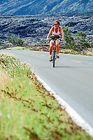 woman biking the Chain of Craters Road, Hawaii, USA Volcanoes National Park, Big Island, Hawaii, USA, Pacific Ocean