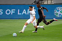 LOS ANGELES, CA - OCTOBER 25: Sebastian Lletget #17 of the Los Angeles Galaxy moves past Jose Cifuentes #11 of LAFC during a game between Los Angeles Galaxy and Los Angeles FC at Banc of California Stadium on October 25, 2020 in Los Angeles, California.