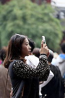 A woman uses her cellphone to take pictures of the Yuyuan Garden.<br /> <br /> To license this image, please contact the National Geographic Creative Collection:<br /> <br /> Image ID: 2169182  <br /> <br /> Email: natgeocreative@ngs.org<br /> <br /> Telephone: 202 857 7537 / Toll Free 800 434 2244<br /> <br /> National Geographic Creative<br /> 1145 17th St NW, Washington DC 20036
