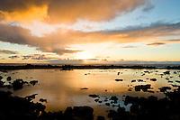 Sunset illuminates Shark's Cove on the North Shore