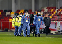 9th January 2021; Brentford Community Stadium, London, England; English FA Cup Football, Brentford FC versus Middlesbrough; Marcus Browne of Middlesbrough is stretchered off injured during the 1st half