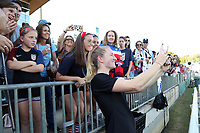 Cary, NC - Sunday October 22, 2017: Samantha Mewis takes a selfie with fans after an International friendly match between the Women's National teams of the United States (USA) and South Korea (KOR) at Sahlen's Stadium at WakeMed Soccer Park. The U.S. won the game 6-0.