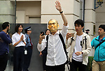 September 22, 2017, Tokyo, Japan - The first customer wearing a mask of Steve Jobs enters an Apple store to purchase Apple's iPhone 8 in Tokyo on Friday, September 22, 2017. The new iPhone 8 and 8 Plus featuring wireless battery charging are launched in Japanese market.    (Photo by Yoshio Tsunoda/AFLO) LWX -ytd-