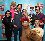 "Veronica J. Kuehn, Jason Jacoby and Matt Dengler with Avenue Q & Puppetry Fans during ""Avenue Q"" Celebrates World Puppetry Day at The New World Stages on 3/21/2019 in New York City."