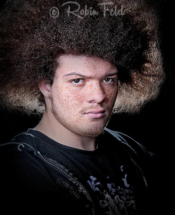 Studio Portrait, color portrait of young man with big hair