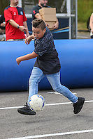 A young fan enjoys a game of football during the 2016/17 Kit Launch of Wycombe Wanderers to the public at Adams Park, High Wycombe, England on 10 July 2016. Photo by David Horn.